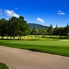 A view of a green protected by bunkers at Hacienda Nueva Country Club